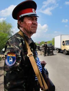 A Don Cossack guards a checkpoint near the entrance to Luhansk.