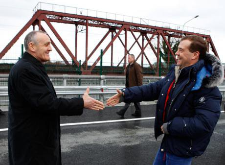 Former president Dmitry Medvedev shakes hands with former president Aleksandr Ankvab at a Russia-funded bridge in January 2012.