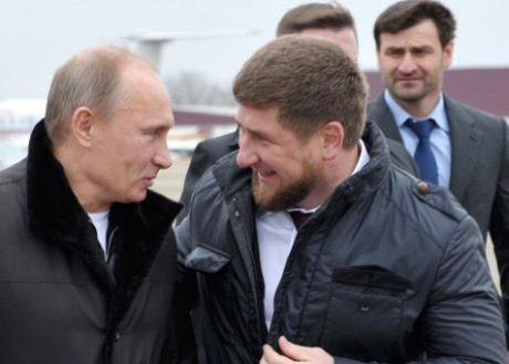 Kadyrov and Putin talk on an airfield in December 2011.