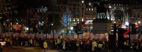 Photo of marchers in a city street at night