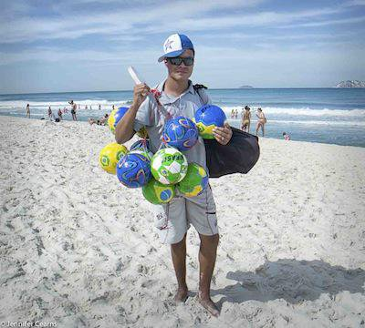 Selling footballs on Ipanema beach