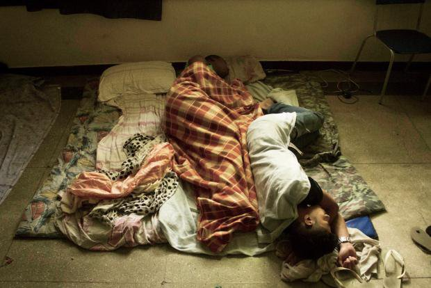 School students sleeping on the floor of their school in Meier, Rio de Janeiro, Brazil