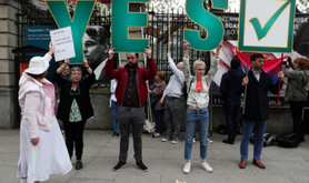 An anti-abortion activist confronts pro-choice campaigners in Dublin, 15 May 2018.
