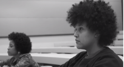 two Black women students alone in a lecture hall