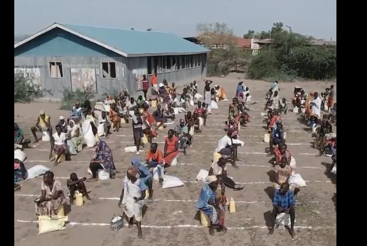 Kakuma Camp in Kenya trying to keep refugees queuing for food safe.
