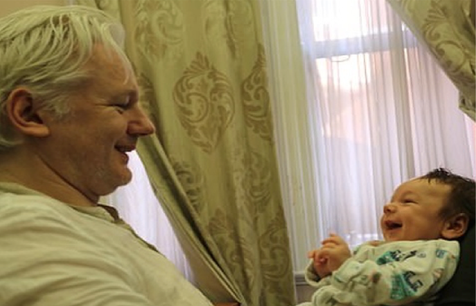 Julian Assange and his baby.