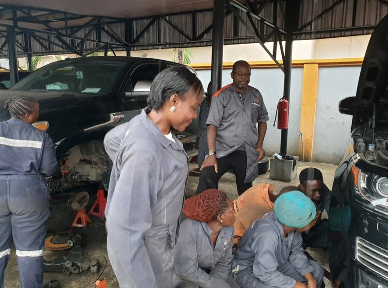 Several people working on a car