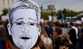 Snowden mask at Freedom not Fear march, Berlin. Flickr/mw238. Some rights reserved.