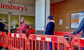 Social_distancing_queueing_for_the_supermarket_J._Sainsbury's_north_London_Coronavirus_Covid_19_pandemic_-_30_March_2020.jpg