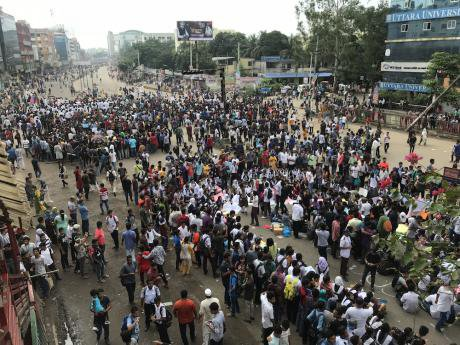 Students spilled onto the streets in Dhaka, shutting down major roads in protest