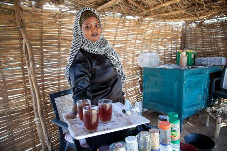 Sudanese woman serving tea