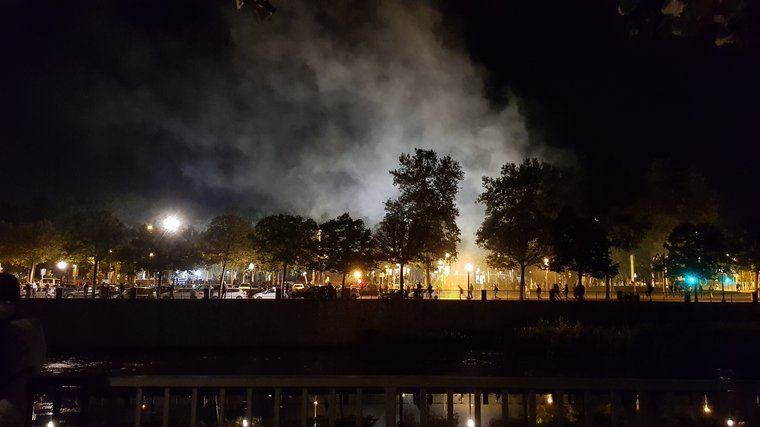 """""""A cloud of teargas rises above the river"""" in Girona."""