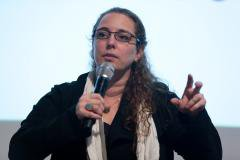 Photo of Tania Bruguera with microphone in hand