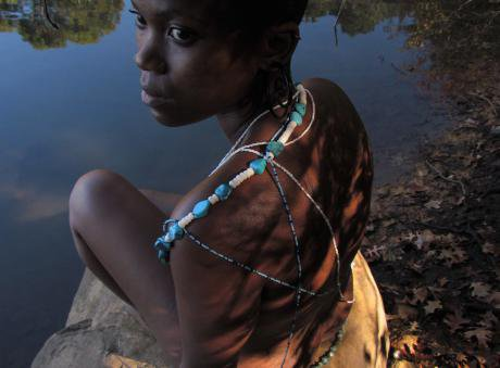 A young woman with beads.