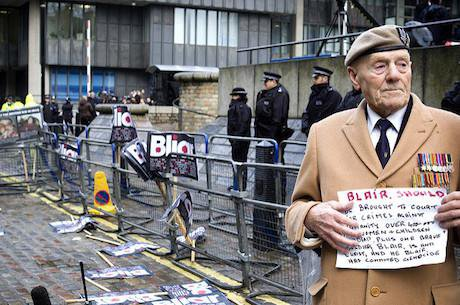 A 'Stop the War' demonstrator calls for Blair to be prosecuted for war crimes. Photo: lewishamdreamer. Flickr. CC