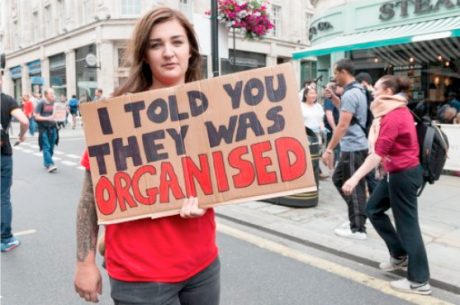Woman protesting cuts in the UK, 2016.