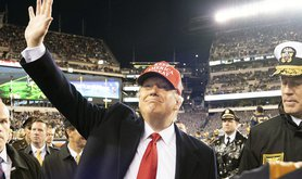 President Donald J. Trump waves to the crowd as he departs the 120th Army-Navy football game at Lincoln Financial Field in Philadelphia, Pa., 14 December 2019