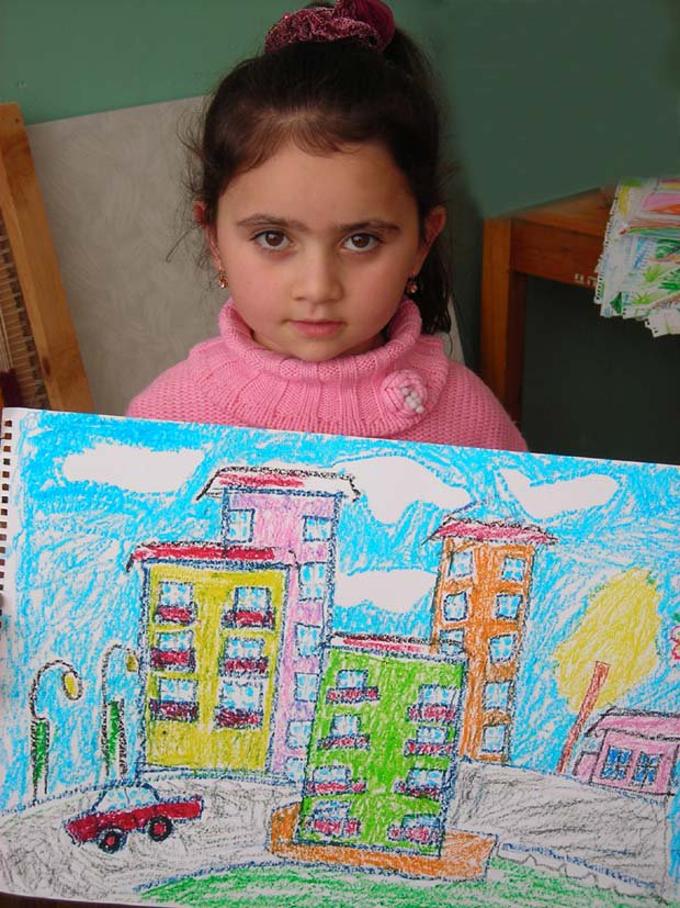 Tskhinvali girl with picture of buildings