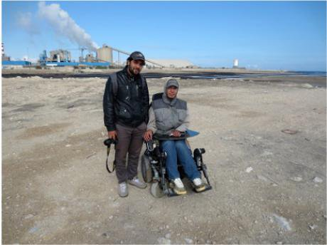 Nader Shkiwa and Mohamed Rigui on beach next to GCT Fertilizer Factory
