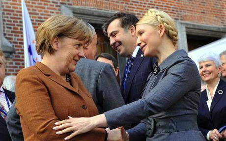 Tymoshenko with German Chancellor Angela Merkel. Tymoshenko is expected to make gains in the polls.