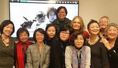 Posed photo of 11 women