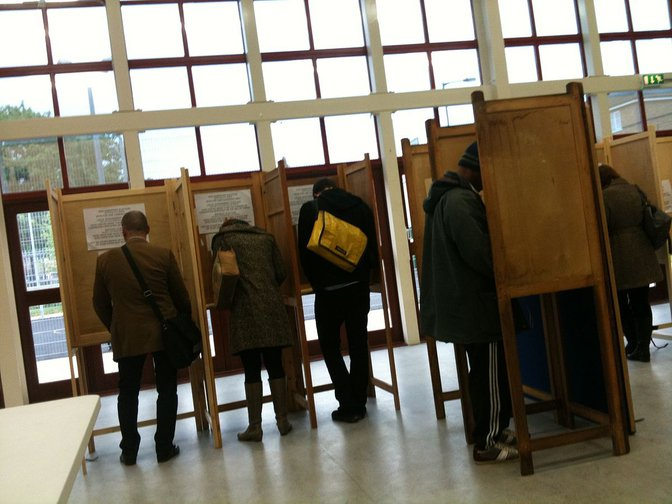 Voters in polling booth