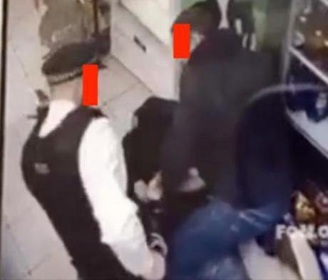 Witness 1 and police officer BX47 handcuff Rashan Charles on the floor of a Hackney convenience store, Saturday 22 July 2017