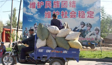 Chinese government propaganda poster in Xinjiang, 2011