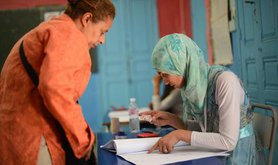 Legislative elections in Tunisia. Checking identity before the vote. 26 October  2014 Tunis.