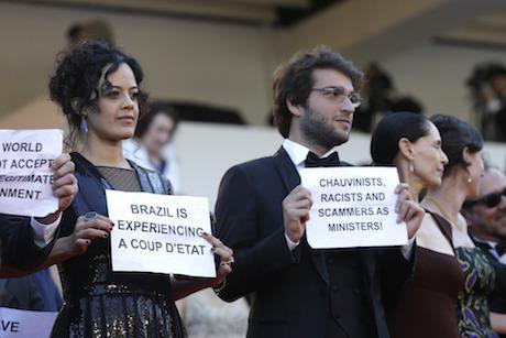 Cast of Aquarius hold placards protesting Brazil's political situation at Cannes Film Festival. Credit: Lionel Cironneau/AP/Pres