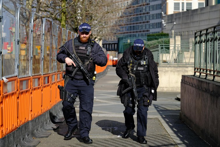 Armed police patrol the perimeter of MI6