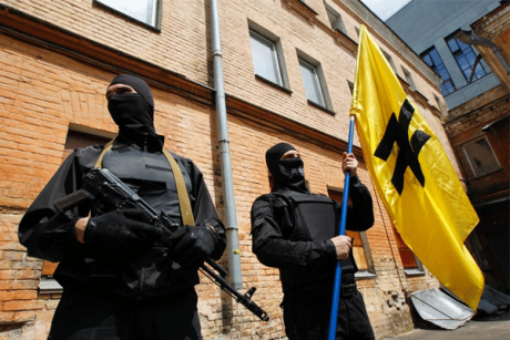 Fighters of the Azov battalion under the flag of the SNA featuring a wolf's hook.