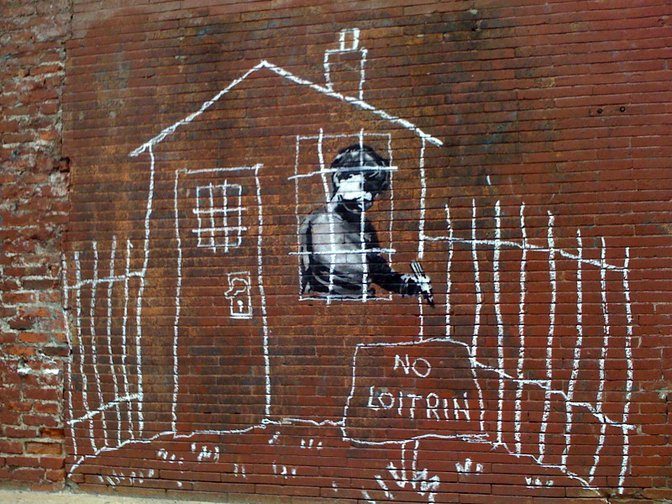 'No Loitrin' graffiti with child, by Banksy