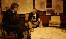 Bremer and Rumsfeld chat over some light refreshments, 2003. Wikimedia Commons. Public Domain.