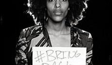 Bring Back Our Girls campaigner with placard and hashtag