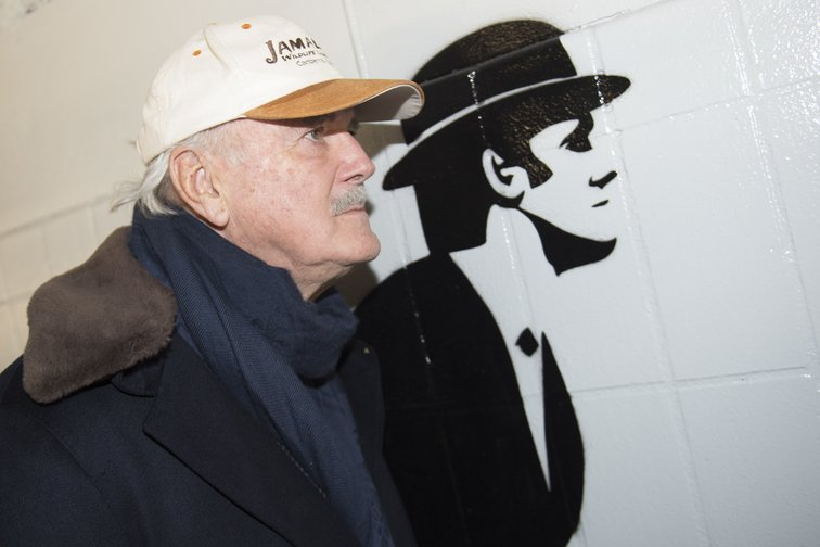John Cleese posing by graffiti in a cycling tunnel in the Netherlands, 2016