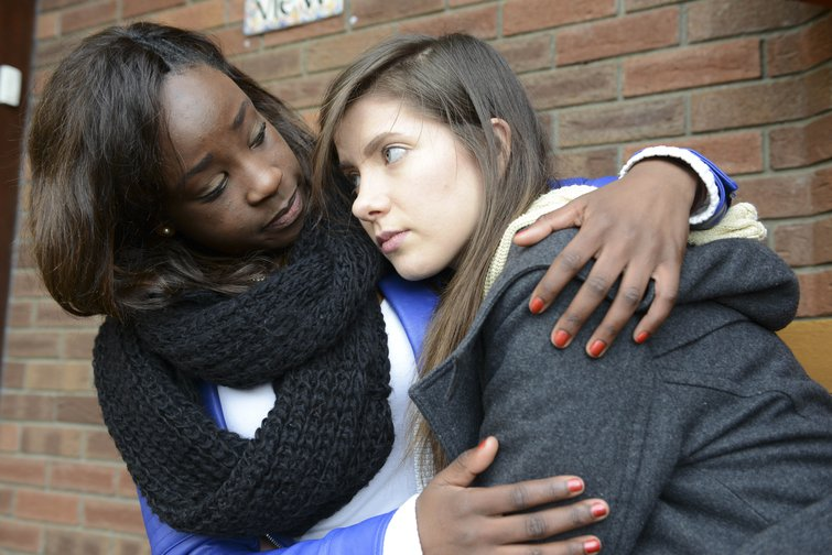 Woman comforting a friend