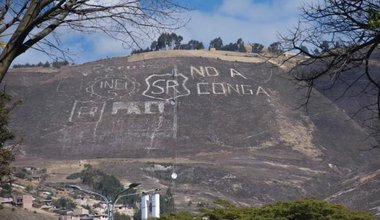 Hillside with 'No a Conga' carved on its side