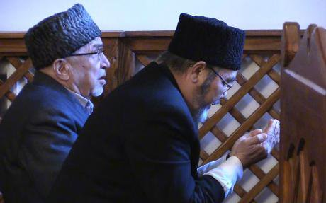 Two Muslim Tatars praying at mosque.