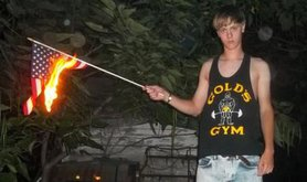 Dylann Roof burning an American flag.