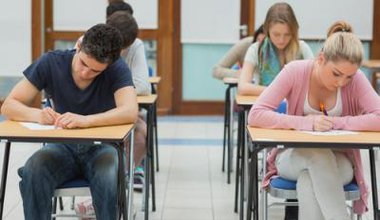 mixed group of students taking an exam