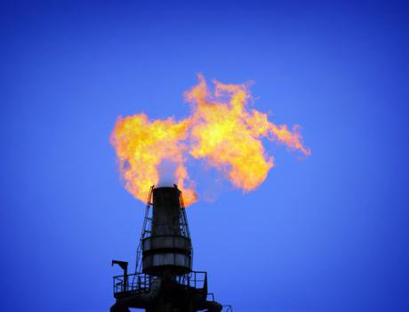A gas flame burns at a gas refinery.