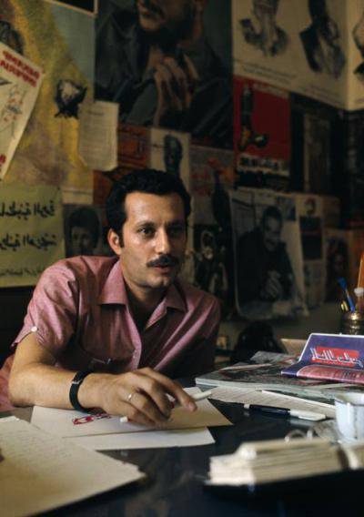 Ghassan at his desk, 1970. Bruno Barbey/ the Palestine poster project archive.