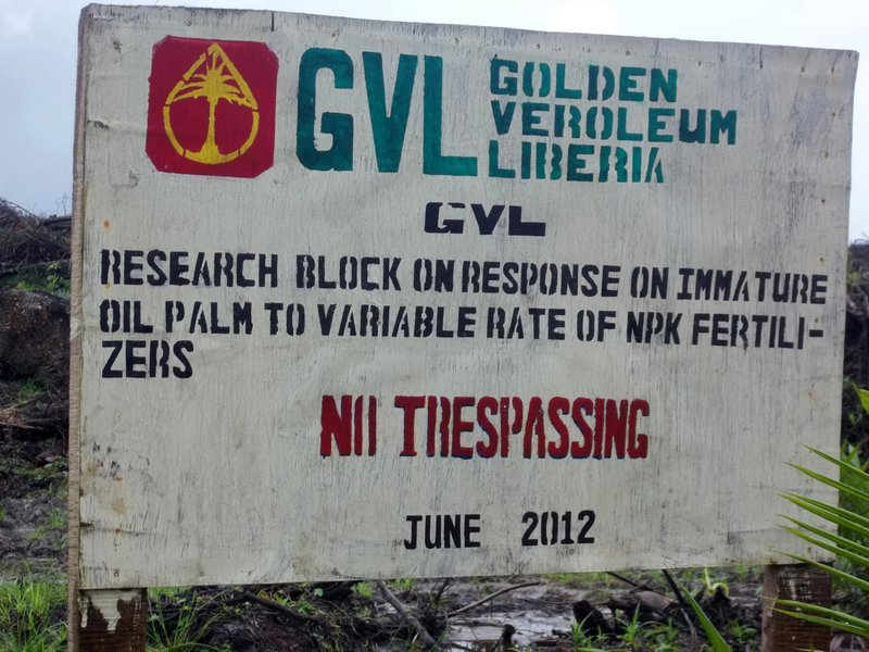 "A sign headed ""Golden Veroleum Liberia"" warning no trespassing"