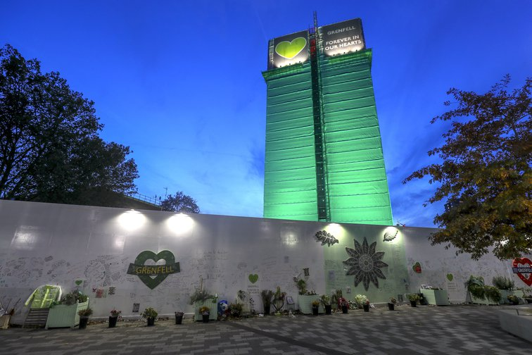 Grenfell Tower lit up in green to commemorate the fire