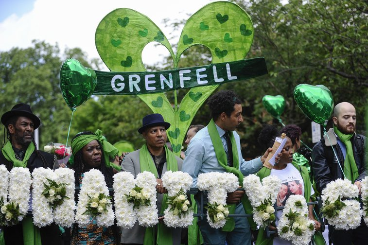 Survivors and relatives take part in a silent march in Ladbroke Grove on the first anniversary of the Grenfell disaster