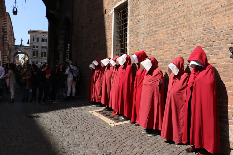 Handmaids outside a church in Verona, Italy 2019.