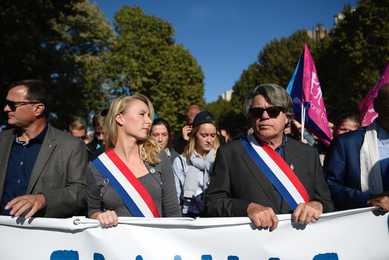 French far-right leaders Marion Maréchal-Le Pen and Gilbert Collard at a demonstration of La Manif Pour Tous in 2016