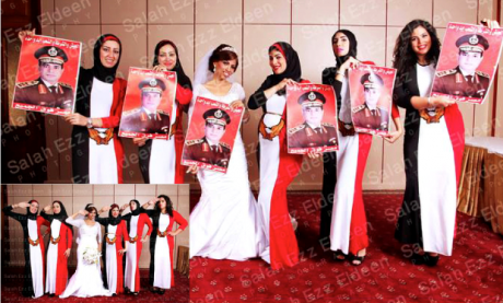 Six young women wearing dresses in the colours of the Egyptian flag (and one in a bridal dress) hold up posters of Sisi.