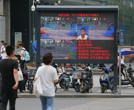 Chinese authorities use facial recognition technology to catch and publicly shame jaywalkers